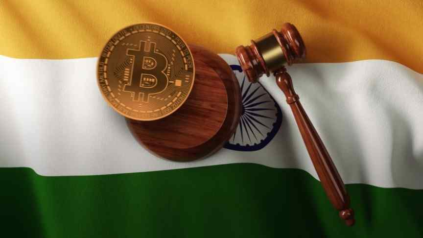 court gavel and bitcoin laying on India flag