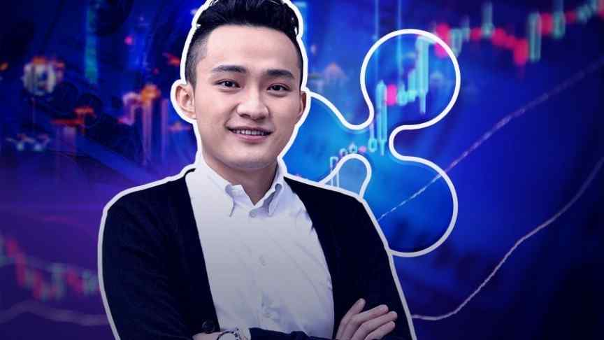 Justin Sun, hands crossed, on background of ripple logo