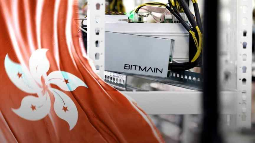 Bitmain logo on mining rig with yellow-black cables going out of it, Hong Kong flag