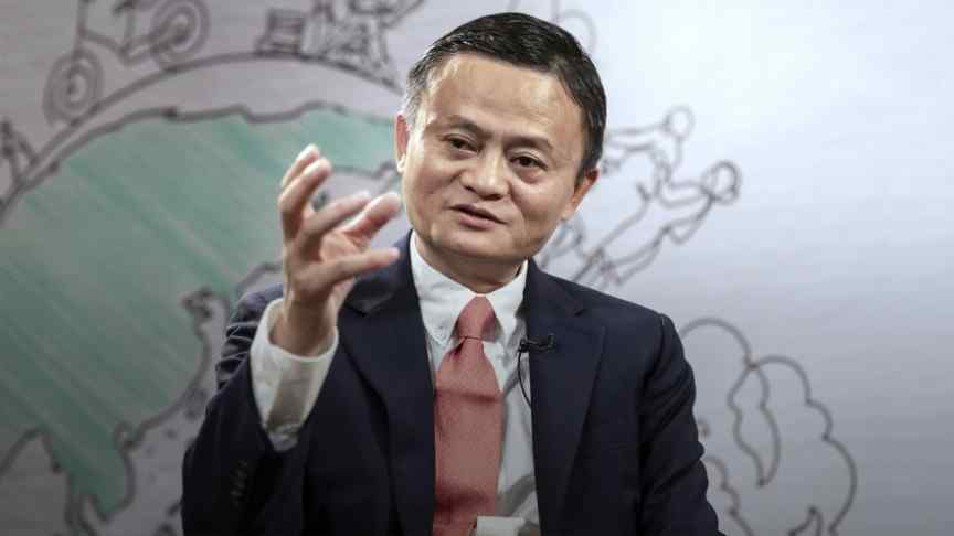 Jack Ma in suit, red tie, raisedhand, a picture of the globe in the background