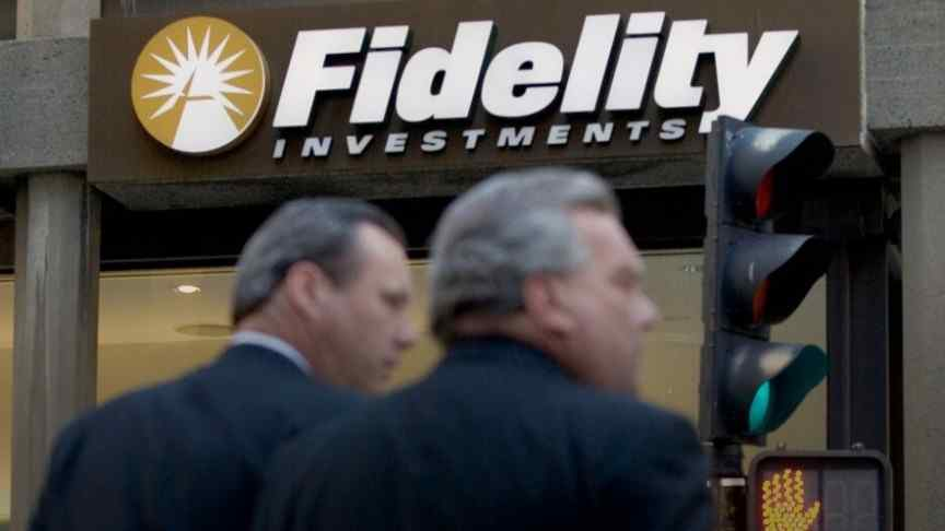 two man standing in front of fidelity building entrance