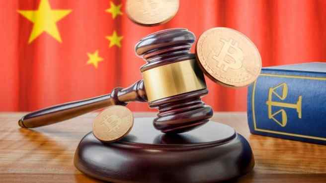 court gavel, bitcoins and book on wooden table, china's flag