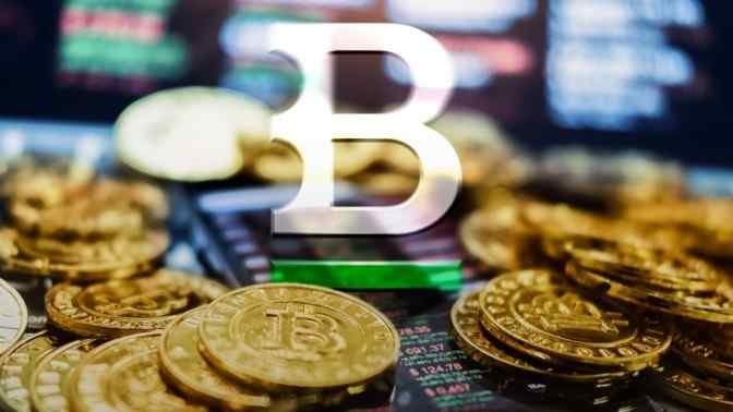 gold bitcoins scattered on screen, B sign in white