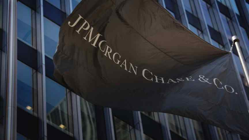 JPM flag waving in front of building