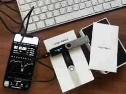 Ledger Nano S Hardware Wallet, a mobile phone and part of a computer keyboard