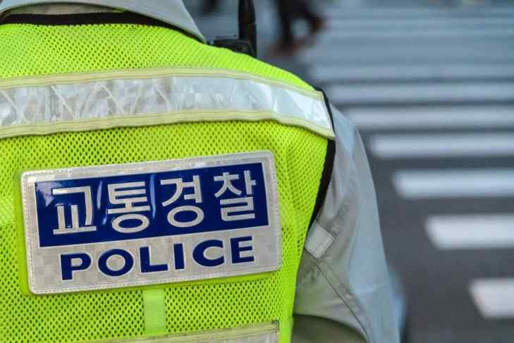 Close detail on South Korean police uniform