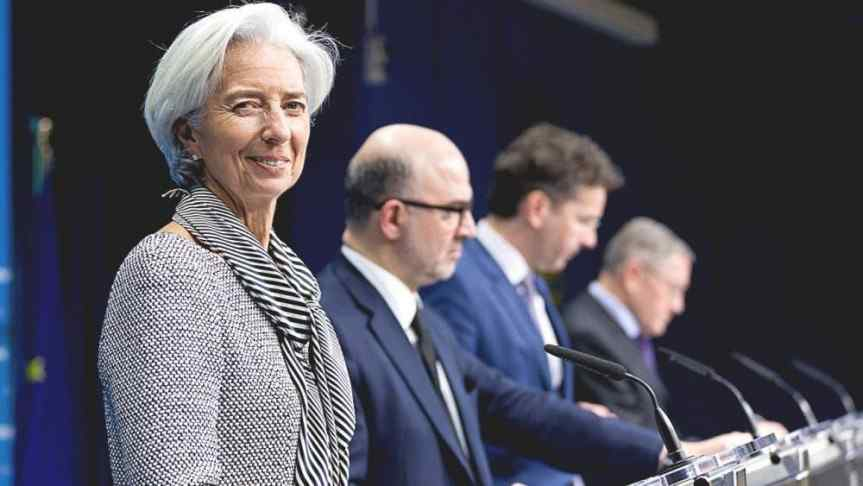 Image of Christine Lagarde and three suited men