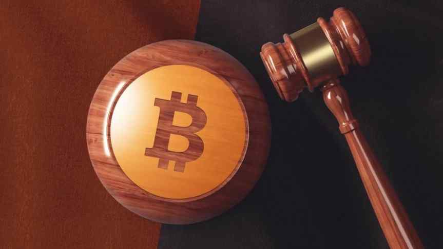 A gavel and the Bitcoin logo