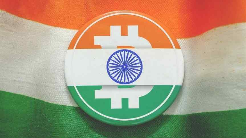 Bitcoin logo in the colours of India's flag and the indian flag as a background