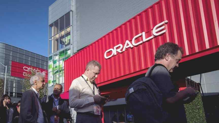 People in front of an Oracle building