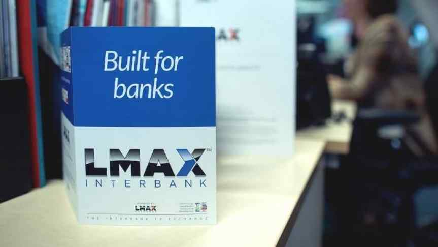 Office room image with a closeup on a flyer saying 'LMAX - Built for banks'