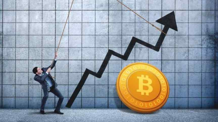 Man pulling a chart using a rope and a Bitcoin supported by the wall