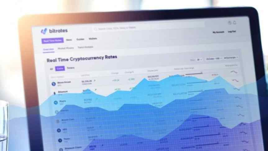 Real time cryptocurrency rates page displayed on a laptop screen