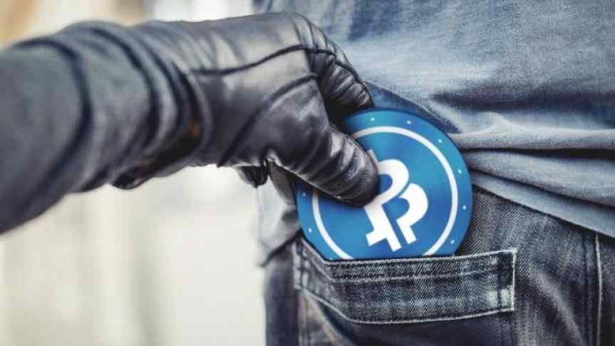 Hand in leather glove smuggling a Bitcoin from a pocket