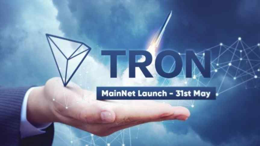 Illustration of a hand showing the Tron logo and the announcement of its MainNet launch