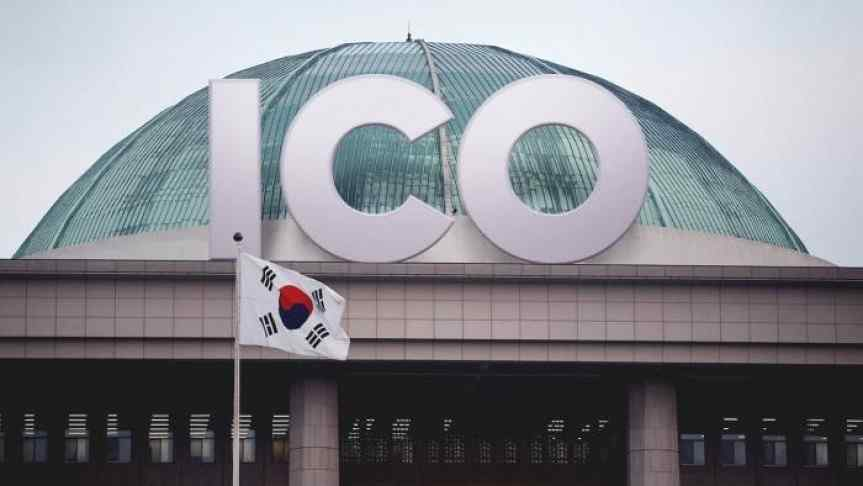 Closeup on Korean National Assembly's dome with letters I, C and O written over it.