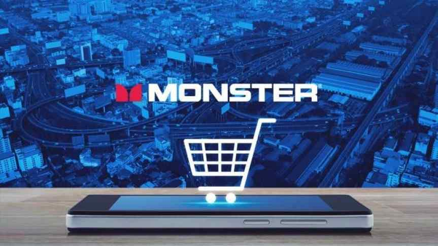 Monster headphone company logo and a shopping cart perpendicular to a mobile phone; cityscape background.
