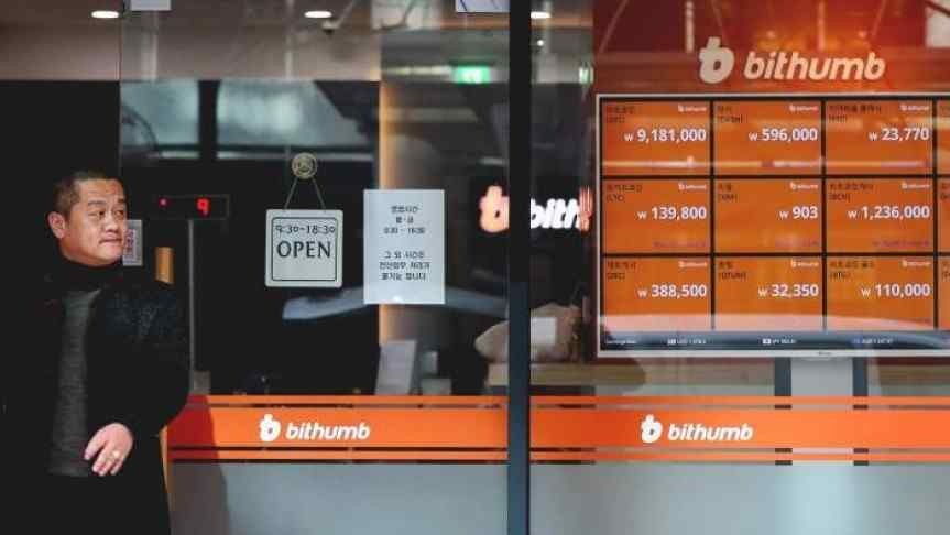 Korean man in front of a Bithumb office