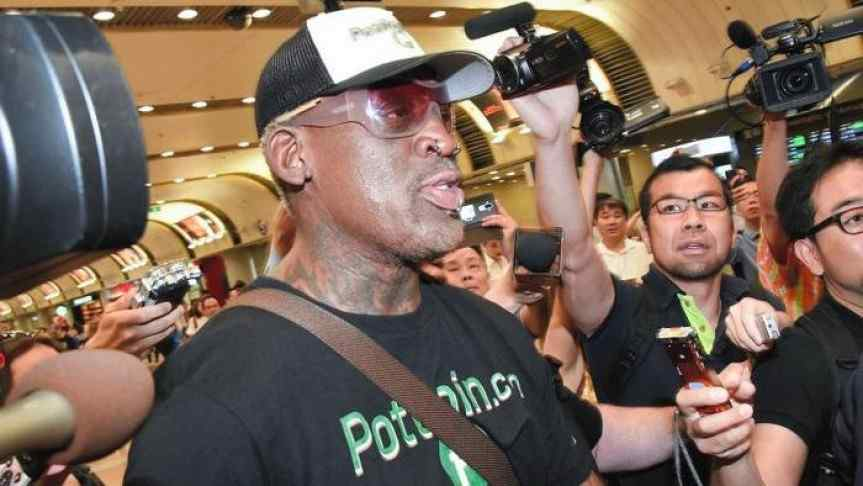Dennis Rodman being photographed by Asian people