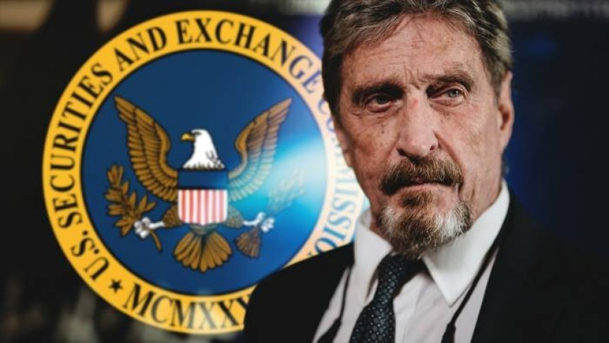 John McAfee in a suit and tie, behind him the U.S. Securities and Exchange Commission logo