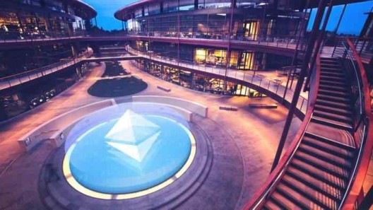 Stanford blockchain research campus, blue Ethereum logo in the center, stairs on the right, glass-window buildings around