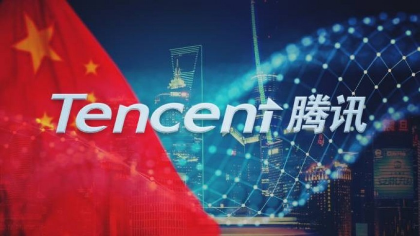 Tencent English and Chinese name on background of red flag with stars, blurry net and skyscrapers