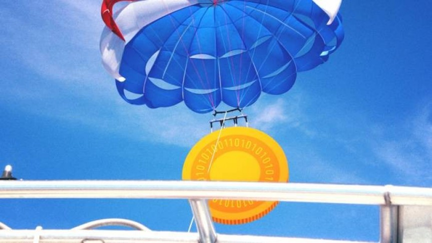 Hot air balloon in red white and blue carrying big cryptocurrency coin on background of blue sky seen from rail of ship