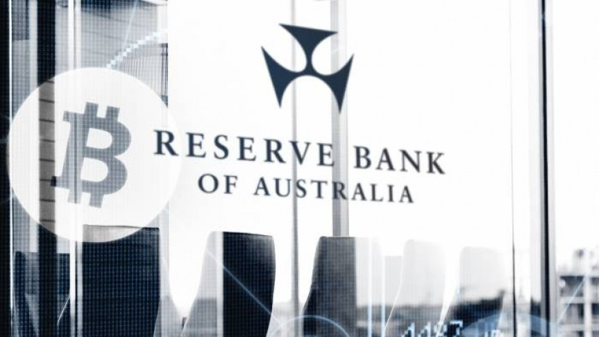 Black and white picture with Bitcoin logo and Reserve Bank of Australia name and logo on background of office buildings