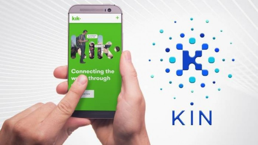left hand finger pushes button on smartphone showing Kik's app home screen in green . White background, Kin token logo and name in blue on the right