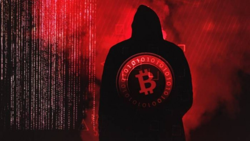 Man in black and hood shown from the back, Bitcoin logo in red on his back, red web and fog in background