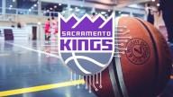 Sacramento Kings logo in grey, purple and white. Image of basketball on basketballcourt