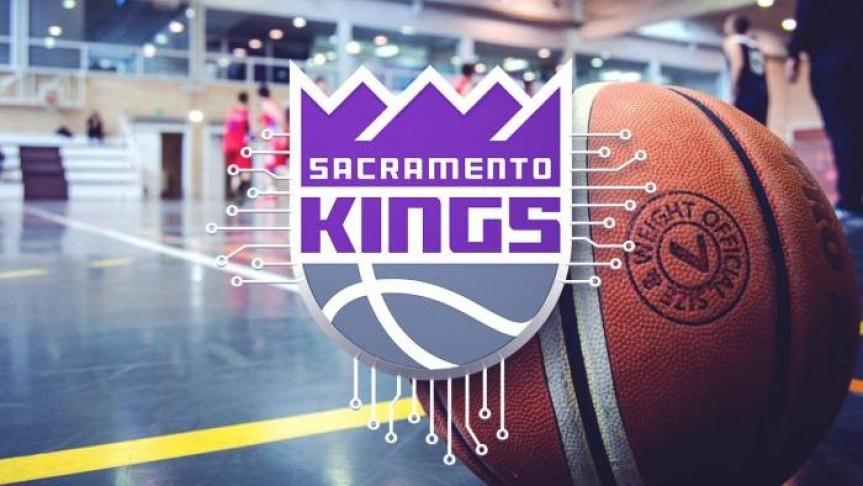 Sacramento Kings logo in grey, purple and white. Image of basketball on basketballcourt