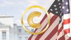 US flag in front of a white house. Golden C inside golden circle in the front.