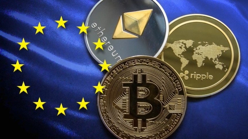 Bitcoin, Ethereum and Ripple gold and silver coins, placed on EU blue flag with yellow stars