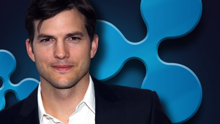 Ashton Kutcher in white shirt and black jacket, Ripple's blue logo on dark-blue background