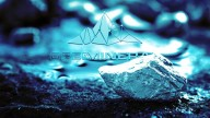 Open Mineral logo in blue on blueish background of earth and rocks