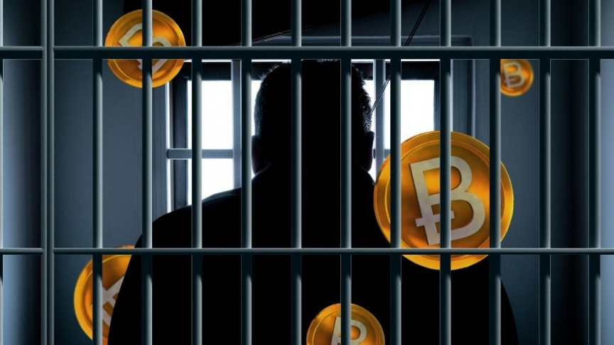 man behind bars, several Bitcoin logos in background