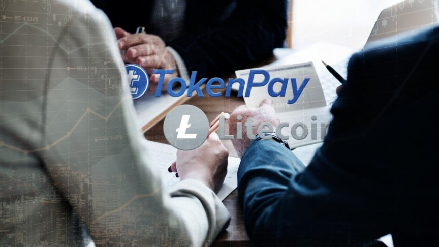 Token Pay and Litecoin names and logos, on background of businessmen in suits sitting around table holding documents