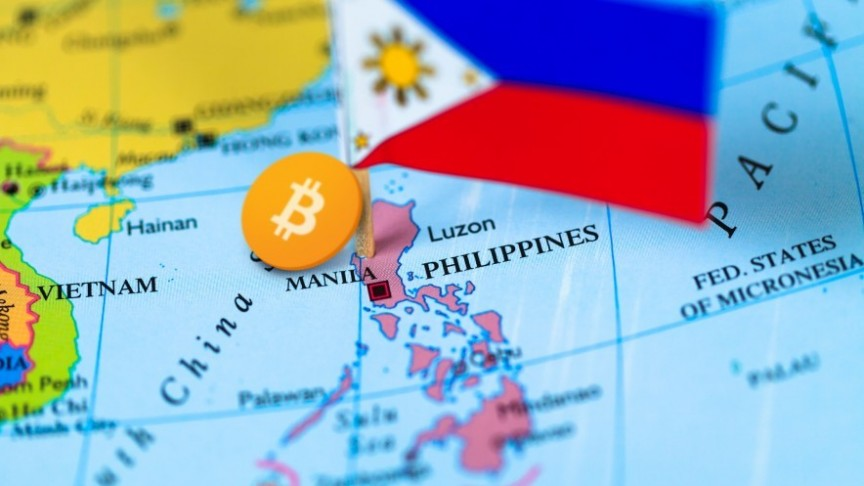 A map of the world, Philippines flag and Bitcoin marking the country's location
