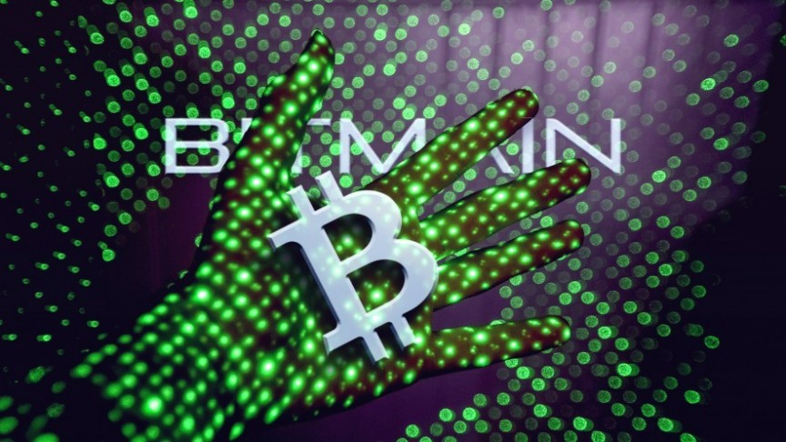 Bitmain Logo and name over hand glowing in green