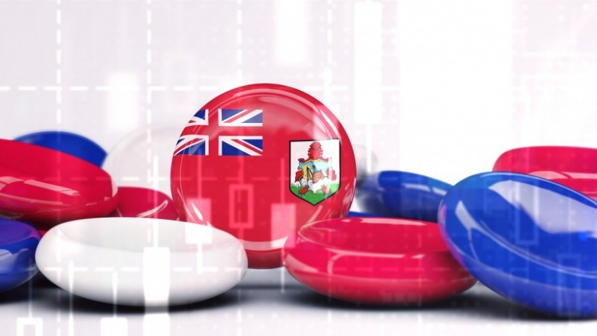 blue, red and white disks, one with UK and Bermuda flags