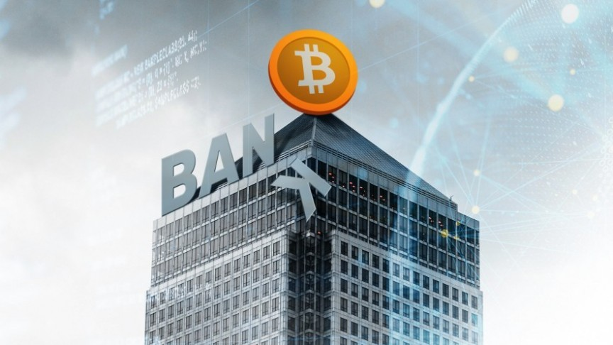 Grey building with BANK sign, with the K falling off, Orange Bitcoin sign on roof.