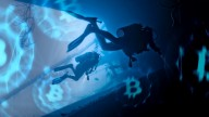 two divers in dark blue waters, Bitcoin logos floating around