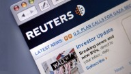 Reuters site showing name and logo and Wall Street news