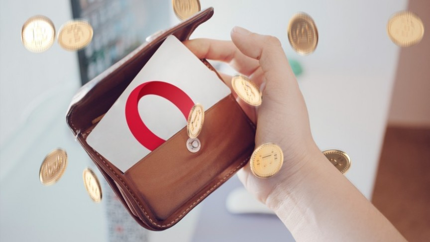 hand holding wallet showing card with Opera logo, gold coins flying around