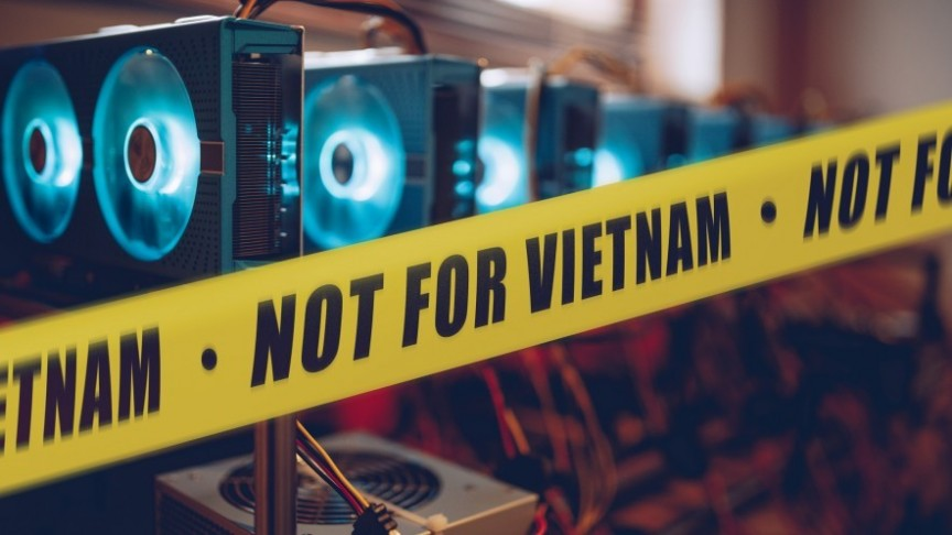 police yellow tape reading 'NOT FOR VIETNAM surrounding lighted mining rigs