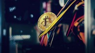 bitcoin held by colorful electrical cords